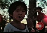 Image of Vietnamese refugee children play Florida United States USA, 1975, second 30 stock footage video 65675050953