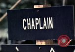 Image of chaplain speaks to Vietnamese refugees United States USA, 1975, second 26 stock footage video 65675050954