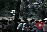Image of chaplain speaks to Vietnamese refugees United States USA, 1975, second 29 stock footage video 65675050954