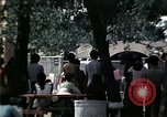 Image of chaplain speaks to Vietnamese refugees United States USA, 1975, second 31 stock footage video 65675050954