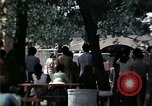 Image of chaplain speaks to Vietnamese refugees United States USA, 1975, second 32 stock footage video 65675050954
