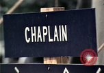 Image of chaplain speaks to Vietnamese refugees United States USA, 1975, second 37 stock footage video 65675050954