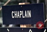 Image of chaplain speaks to Vietnamese refugees United States USA, 1975, second 38 stock footage video 65675050954