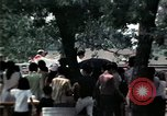 Image of chaplain speaks to Vietnamese refugees United States USA, 1975, second 42 stock footage video 65675050954