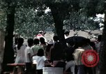 Image of chaplain speaks to Vietnamese refugees United States USA, 1975, second 43 stock footage video 65675050954