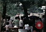 Image of chaplain speaks to Vietnamese refugees United States USA, 1975, second 44 stock footage video 65675050954