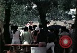 Image of chaplain speaks to Vietnamese refugees United States USA, 1975, second 47 stock footage video 65675050954