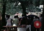 Image of chaplain speaks to Vietnamese refugees United States USA, 1975, second 51 stock footage video 65675050954