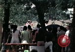 Image of chaplain speaks to Vietnamese refugees United States USA, 1975, second 53 stock footage video 65675050954