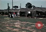 Image of chaplain speaks to Vietnamese refugees United States USA, 1975, second 57 stock footage video 65675050954