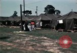 Image of chaplain speaks to Vietnamese refugees United States USA, 1975, second 58 stock footage video 65675050954