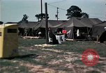 Image of chaplain speaks to Vietnamese refugees United States USA, 1975, second 59 stock footage video 65675050954
