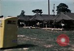 Image of chaplain speaks to Vietnamese refugees United States USA, 1975, second 62 stock footage video 65675050954