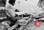 Image of Seminole Native American Indians cook food Florida United States USA, 1919, second 2 stock footage video 65675050982