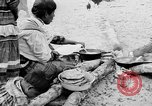 Image of Seminole Native American Indians cook food Florida United States USA, 1919, second 5 stock footage video 65675050982