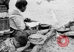 Image of Seminole Native American Indians cook food Florida United States USA, 1919, second 6 stock footage video 65675050982