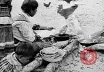 Image of Seminole Native American Indians cook food Florida United States USA, 1919, second 9 stock footage video 65675050982