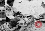 Image of Seminole Native American Indians cook food Florida United States USA, 1919, second 11 stock footage video 65675050982