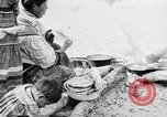 Image of Seminole Native American Indians cook food Florida United States USA, 1919, second 14 stock footage video 65675050982