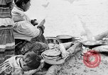 Image of Seminole Native American Indians cook food Florida United States USA, 1919, second 15 stock footage video 65675050982
