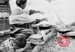 Image of Seminole Native American Indians cook food Florida United States USA, 1919, second 16 stock footage video 65675050982