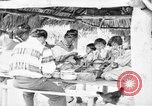 Image of Seminole Native American Indians cook food Florida United States USA, 1919, second 19 stock footage video 65675050982