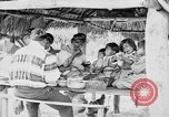 Image of Seminole Native American Indians cook food Florida United States USA, 1919, second 20 stock footage video 65675050982