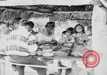 Image of Seminole Native American Indians cook food Florida United States USA, 1919, second 21 stock footage video 65675050982