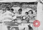Image of Seminole Native American Indians cook food Florida United States USA, 1919, second 22 stock footage video 65675050982