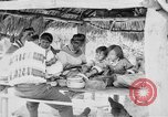 Image of Seminole Native American Indians cook food Florida United States USA, 1919, second 23 stock footage video 65675050982