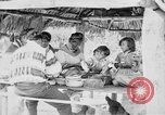 Image of Seminole Native American Indians cook food Florida United States USA, 1919, second 24 stock footage video 65675050982