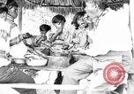 Image of Seminole Native American Indians cook food Florida United States USA, 1919, second 27 stock footage video 65675050982
