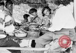 Image of Seminole Native American Indians cook food Florida United States USA, 1919, second 28 stock footage video 65675050982