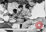 Image of Seminole Native American Indians cook food Florida United States USA, 1919, second 29 stock footage video 65675050982