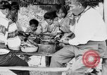 Image of Seminole Native American Indians cook food Florida United States USA, 1919, second 30 stock footage video 65675050982