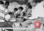 Image of Seminole Native American Indians cook food Florida United States USA, 1919, second 32 stock footage video 65675050982