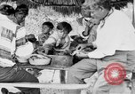 Image of Seminole Native American Indians cook food Florida United States USA, 1919, second 33 stock footage video 65675050982