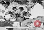 Image of Seminole Native American Indians cook food Florida United States USA, 1919, second 34 stock footage video 65675050982