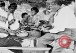 Image of Seminole Native American Indians cook food Florida United States USA, 1919, second 35 stock footage video 65675050982