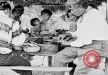 Image of Seminole Native American Indians cook food Florida United States USA, 1919, second 36 stock footage video 65675050982