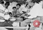 Image of Seminole Native American Indians cook food Florida United States USA, 1919, second 37 stock footage video 65675050982