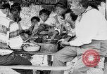 Image of Seminole Native American Indians cook food Florida United States USA, 1919, second 38 stock footage video 65675050982