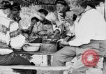Image of Seminole Native American Indians cook food Florida United States USA, 1919, second 39 stock footage video 65675050982