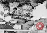 Image of Seminole Native American Indians cook food Florida United States USA, 1919, second 40 stock footage video 65675050982