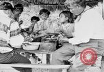 Image of Seminole Native American Indians cook food Florida United States USA, 1919, second 42 stock footage video 65675050982