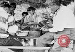 Image of Seminole Native American Indians cook food Florida United States USA, 1919, second 43 stock footage video 65675050982