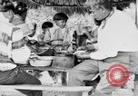 Image of Seminole Native American Indians cook food Florida United States USA, 1919, second 44 stock footage video 65675050982