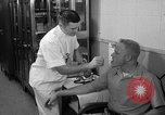 Image of preflight physical checkup United States USA, 1962, second 37 stock footage video 65675051196