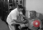 Image of preflight physical checkup United States USA, 1962, second 40 stock footage video 65675051196