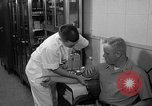 Image of preflight physical checkup United States USA, 1962, second 42 stock footage video 65675051196